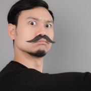 Asian mean office manager with his elegant mustache