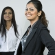Indian Business woman with colleagues in the background out of focus