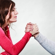Partnership relationship concept. Girlfriend confronts his boyfriend. Woman and man arm wrestling challenge between young couple