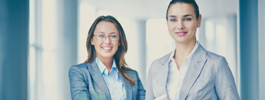 Two successful businesswomen looking at camera